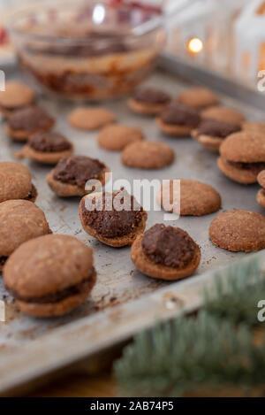 Hazelnut shortbread sandwiches filled with chocolate cream - Stock Photo