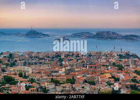 Panorama of old Marseille city, famous If castle and Frioul islands.Colorful evening landscape - Stock Photo