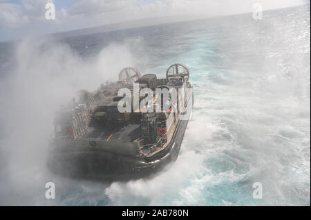 PACIFIC OCEAN (Feb. 9, 2012) Landing Craft Air Cushion (LCAC) 63, assigned to Assault Craft Unit (ACU) 5, departs the well deck of the amphibious assault ship USS Boxer (LHD 4) during exercise Iron Fist 2013. - Stock Photo