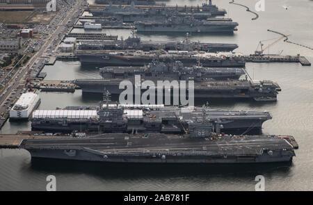 NORFOLK (Dec. 20, 2012) The aircraft carriers USS Dwight D. Eisenhower (CVN 69), USS George H.W. Bush (CVN 77), USS Enterprise (CVN 65), USS Harry S. Truman (CVN 75), and USS Abraham Lincoln (CVN 72) are in port at Naval Station Norfolk, Va., the world's largest naval station. - Stock Photo