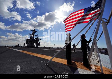 SAN DIEGO BAY (Feb. 11, 2012) Sailors shift colors on the flight deck aboard the Nimitz-class aircraft carrier USS Carl Vinson (CVN 70). - Stock Photo
