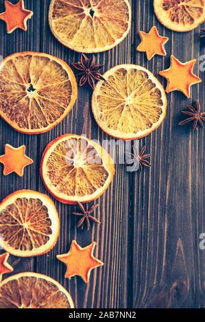 dried orange slices on dark wooden table backround. copyspace flatlay top view - Stock Photo