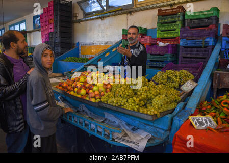 Sousse, Tunisia -  7 November 2019: people selling fruits at the market on the medina of Sousse in Tunisia - Stock Photo