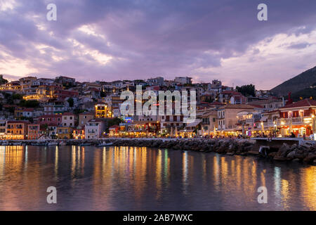 Evening view of Parga restaurants and bars, Preveza, Greece, Europe - Stock Photo