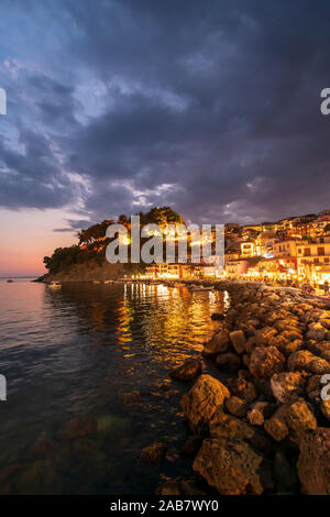 Sunset at Parga Castle and harbour, Parga, Preveza, Greece, Europe - Stock Photo