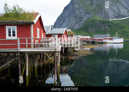 Rorbuer, traditional fishermnen's cottages now used for tourist accommodaton in Reine, Moskenesoya, The Lofoten Islands, Norway, Europe - Stock Photo