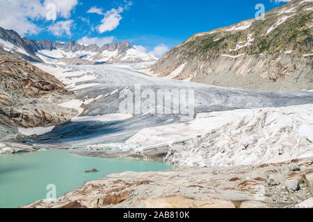 Glacial lake and Rhone Glacier partially protected by blankets to slow melting, Gletsch, Canton of Valais, Switzerland, Europe - Stock Photo