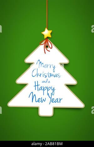 Ein dekorativer Weihnachtsbaum vor gruenem Hintergrund - Stock Photo