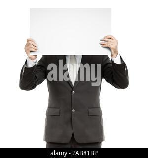 Ein Geschaeftsmann, der ein unbeschriebenes Schild in der Hand haelt - Stock Photo