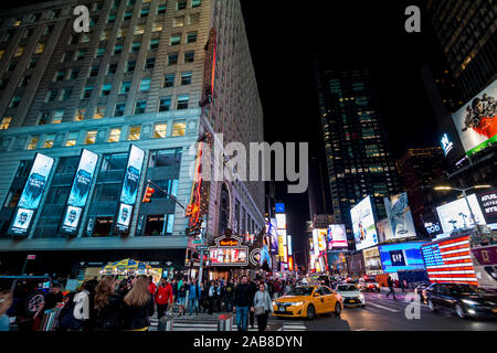 New York city, United States: October 15, 2019: Times Square, a busy and crowded intersection in Manhattan, with many neon ads in an iconic street of - Stock Photo
