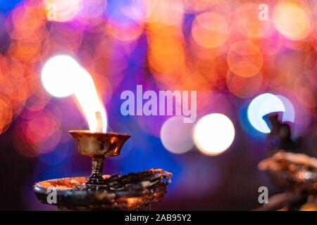 Diwali candle diya or butter lamps with bokeh. - Stock Photo