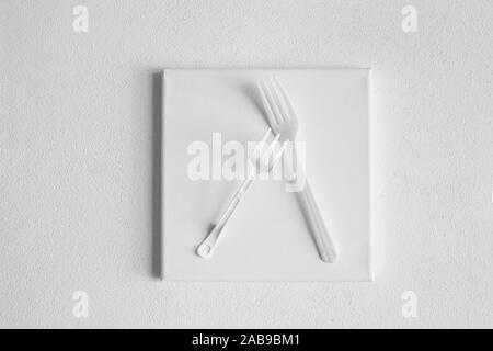 two disposable white plastic fork for on canvas frame texture with cement wall background in environmental pollution concept - Stock Photo