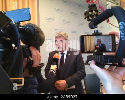 Schwerin, Germany. 26 November 2019, Mecklenburg-Western Pomerania, Schwerin: Lorenz Caffier (CDU), Interior Minister of Mecklenburg-Vorpommern, gives an interview after a press conference. Previously, a report had been presented for which a commission had been investigating the situation in the special units of the national police since July. Right-wing extremists and xenophobic attitudes are not a fundamental problem for the special forces in Mecklenburg-Western Pomerania, according to the Commission on the recent activities of the SEK. Credit: dpa picture alliance/Alamy Live News - Stock Photo