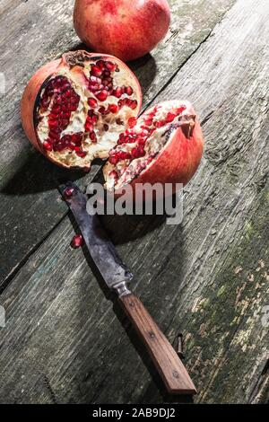 Pomegranate on vintage wooden table. Stock Photo