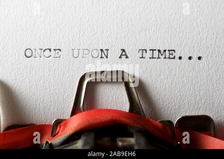 The sentence, once upon a time, written with a typewriter. - Stock Photo