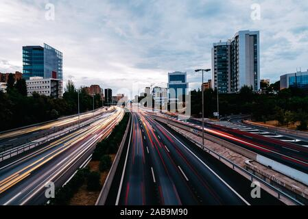 M30 motorway in Madrid at sunset. Long exposure with traffic light trails. - Stock Photo