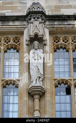 statue of St John the Baptist by Eric Gill in the front quad in the gate tower of St John's College Oxford part of the University