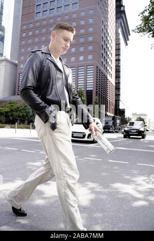 Man walking on the street. Frankfurt am Main, Germany. - Stock Photo