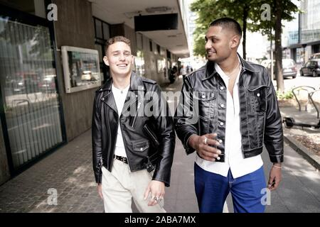 Two men walking on the street. Frankfurt am Main, Germany. - Stock Photo