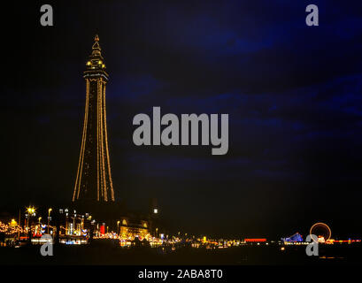 Blackpool tower and the Golden mile at night. Lancashire. England. UK - Stock Photo