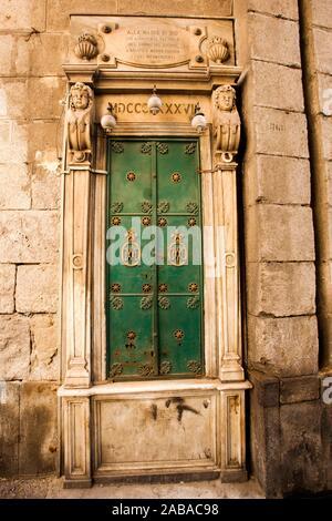 Door next to Saint Gennaro Gate, Porta San Gennaro is one of the ancient gates of the city, Naples city, Campania, Italy, Europe. - Stock Photo