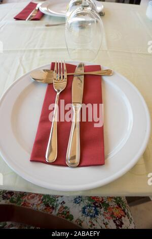 Table set with napkin in red. - Stock Photo