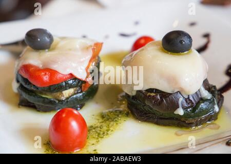 Grilled slices of eggplant and tomatoes with cheese on top Spain. - Stock Photo