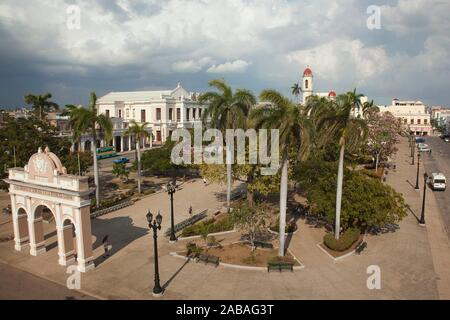 View to the Tomas Terry Theatre-Teatro Tomas Terry, Arco de Triunfo-Triumpf Arch and Cathedral at Jose Marti Park, Cienfuegos, Cuba, West Indies, - Stock Photo