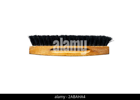 Brush for polishing shoes with black bristles, isolated on a white background with a clipping path. - Stock Photo
