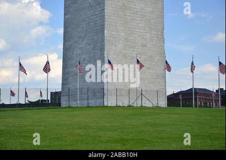 Washington Monument with green field, Washington DC, USA - Stock Photo