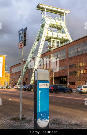 Double trestle pit frame above shaft 7 of the disused Ewald mine in Herten, charging station for electric cars, Herten municipal utility, - Stock Photo