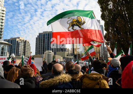 Torontonians gather at Mel Lastman Square to show support for the protesters in Iran while condemning the regime, while a pre-revolution flag waves. - Stock Photo