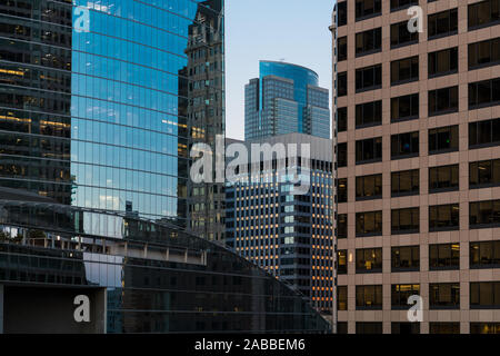 Close up view of modern office and residential skyscrapers at sunset with contrasting designs and colors in downtown Los Angeles, California, USA