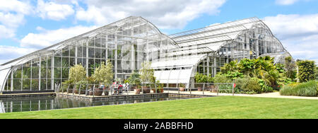 Royal Horticultural Society Gardens Bicentinary glasshouse structures home to RHS tender plant collection in lakeside setting Wisley Surrey England UK - Stock Photo