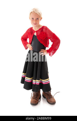 Pretty young blonde girl dressing up in Dad's big walking boots. Isolated on white background - Stock Photo