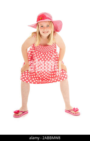 Full length shot of beautiful young blonde girl in big pink floppy hat, a polka dot dress and flip flops. Isolated on white studio background - Stock Photo