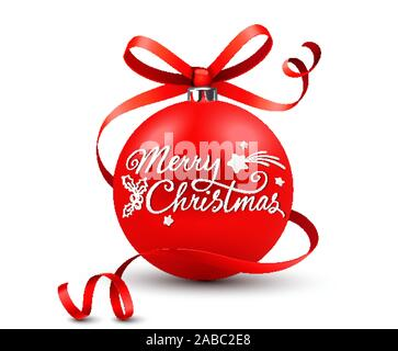 Red christmas bauble with calligraphic lettering and curled bow and ribbon. Merry christmas - Stock Photo