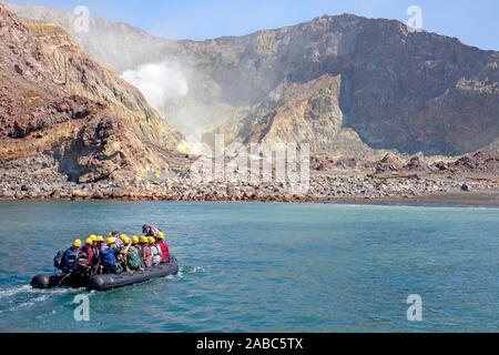 Zodiac heading ashore at Whakaari (White Island) - Stock Photo