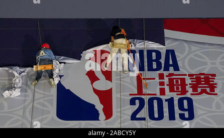 Construction workers dismentle a giant poster of NBA before 2019 NBA Shanghai in Lujiazui, Shanghai, China, 9 October 2019. - Stock Photo