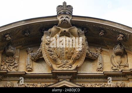 royal coat of arms combined with the Prince of Wales' feathers carved above an entrance to a building in St John's College Oxford