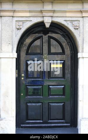 quaint doorway in the front quad in st john's college oxford with the symbol of the lamb and flag above it on the right