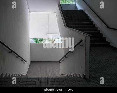 Wide angle view of an empty stairwell / staircase in an old industrial building - Stock Photo