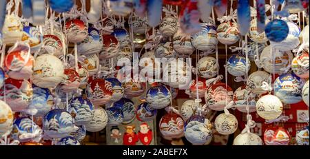 many hanging beautifull decorated Christmas ornament decorations - Stock Photo