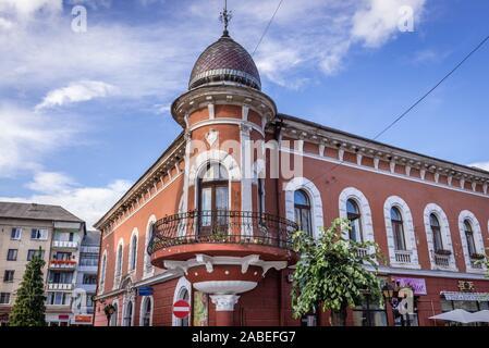 Building in Sighetu Marmatiei city in Maramures County of northwestern Romania - Stock Photo