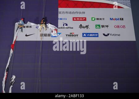 Construction workers dismentle the sponsor board for NBA before 2019 NBA Shanghai in Lujiazui, Shanghai, China, 9 October 2019. - Stock Photo