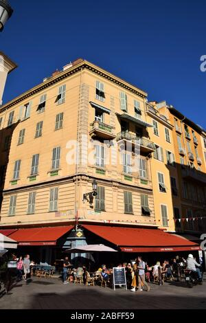Restaurant in Old Town Nice France with clear blue sky - Stock Photo