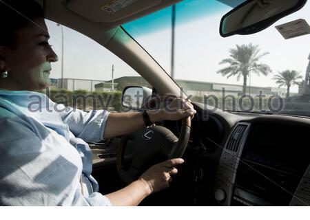 UAE - Dubai - Simin Ghoraishian driving in Jebel Ali Freezone. - Stock Photo