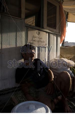 UAE - Dubai - Iranians loading goods on the boats parked in the creek. - Stock Photo