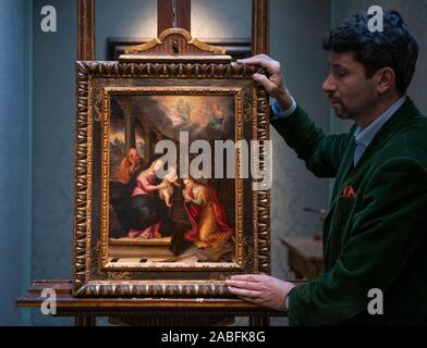 Mayfair, London, UK. 27th November 2019. The galleries and auction houses of London Art Week open their doors for the third LAW Winter, from 1st-6th December 2019. Image: Carlo Milano holds female artist Lavinia Fontana's (1552-1614) Mystic Marriage of St. Catherine (painted before 1577), oil on copper on display at Callisto Fine Art for London Art Week. Credit: Malcolm Park/Alamy Live News. - Stock Photo
