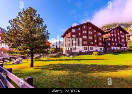 Zermatt, Switzerland town street view in famous swiss ski resort, colorful traditional houses, snow mountains